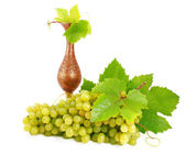 Green grapes and copper amphora. — Stock Photo