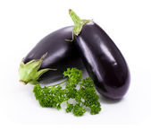 Fresh eggplant with parsley branch — Stock Photo