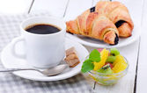 Coffee, croissant and fruits — Stock Photo