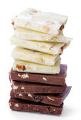 Chocolate slices. White and dark chocolate and shredded nut — Stock Photo