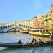 VENICE - March 28: Gondola at Rialto Bridge on March 28, 2012 in — Stock Photo