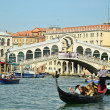 VENICE - March 28: Gondola at Rialto Bridge on March 28, 2012 in - Stock Photo