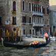 VENICE, ITALY - MARCH 28: Tourists on a Gondola, March 28, 2012 — Stock Photo