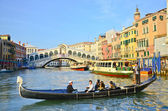 VENICE - March 28: Gondola at Rialto Bridge on March 28, 2012 in — Stock Photo