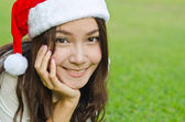 Beautiful young santa clause woman — Stockfoto