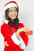 Girl in Santa holding red card — Stock Photo