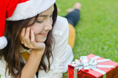 Santa claus hat with red christmas gift box — Stock Photo