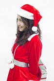 Santa claus girl with gift box in hands over white — Stock Photo