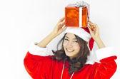 Santa claus klobouk s šedou vánoční dárková krabička — Stock fotografie