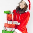 Santa claus hat with christmas gift boxes — Stock Photo