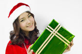 Santa claus hat with green christmas gift box — Stock Photo