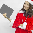 Girl in Santa holding banner. — Stock Photo