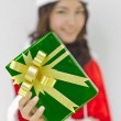 Stock Photo: Santclaus hat with green christmas gift box