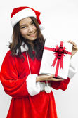 Santa claus hat with grey christmas gift box — Stock Photo
