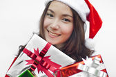 Santa claus hat with christmas gift boxes — Stock fotografie