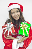 Santa claus hat with christmas gift boxes — Stockfoto
