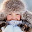 Happy young girl in a fur hat — Stock Photo #17702319