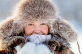 Happy young girl in a fur hat — Stock Photo