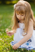 Girl with sunflower in summer field — Stock Photo
