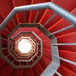 Spiral staircase of iron covered with a red carpet — Stock Photo #24271903