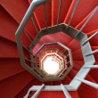 Spiral staircase of iron covered with a red carpet — Stock Photo #24821491