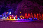 Christmas lights on chapel and trees — Стоковое фото