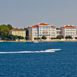 Zadar peninsula waterfront with powerboat — Stock Photo