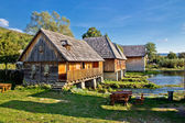 Old historic village on Gacka river source — Stock Photo