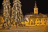 Idylic winter cityscape evening in snow — Stock Photo