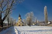 Idyllic winter - Church in snow — Stock Photo