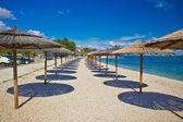 Island of Vir beach umbrellas — Stock Photo