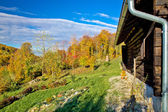Wooden lodge in autumn mountain nature — Stock Photo