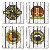 Beer badges and labels on wooden background — Stock Vector