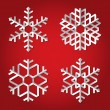 Christmas origami snowflakes on red background - Stock Vector