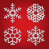 Christmas origami snowflakes on red background — Stock Vector