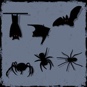 Vector set of spiders and bats — Stock Vector