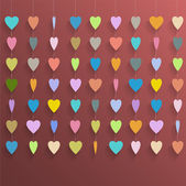 Hanging colorful hearts — Stock Vector