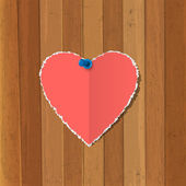 Torn paper heart pinned on wooden background — Stock Vector