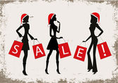 """Women shopping with christmas hats and number """"2014"""" on their bags. — Vetorial Stock"""