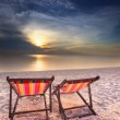 Stock Photo: Couples chairs on sand beach dusky time