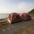 Couples of camping tent in font of sea beach with morning light — Stock Photo