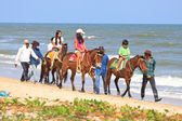 PETCHABURI THAILAND - DEC 5 : visitor riding on horse back at cha - am beach Petchaburi province on Dec 5,2011 ,Cha - am beach is a popular place of thai people to visiting in every holiday — Stock Photo