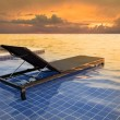 Stock Photo: Pool bed and dusky sky sun set