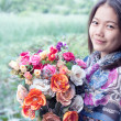 Stock Photo: Womand flower in hand