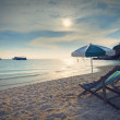 Wood chairs bed and umbrella on sand beach at sun set time — Stock Photo