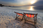 Couples of chairs beach and yatching boat at far in sea — Stock Photo