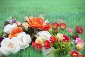 Flowers and green grass field blending picture — Stock Photo