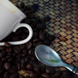 White cup and coffee bean roasted on wood table — Stock Photo
