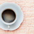 Hot coffee in white cup top view — Stock Photo