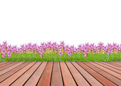 Wood terrace and flower garden — Stock Photo